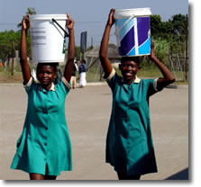 Women carrying water in buckets